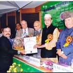 Dr.Prabhakaran recieving 'INDIAN ACHIEVER AWARD FOR HEALTH CARE EXCELLENCE""